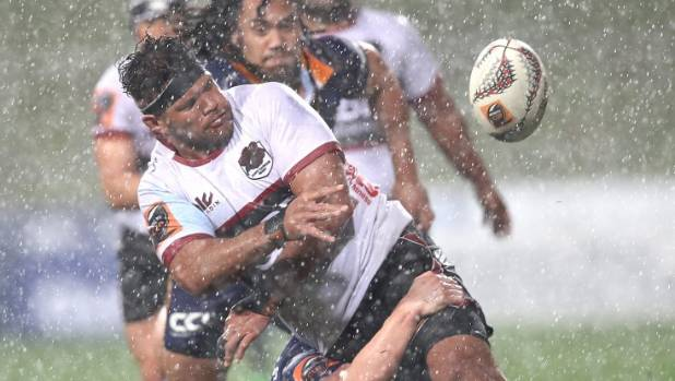 North Harbour's Karl Tuinukuafe gets a pass away despite the wet conditions during the Mitre 10 Cup opener against Otago.