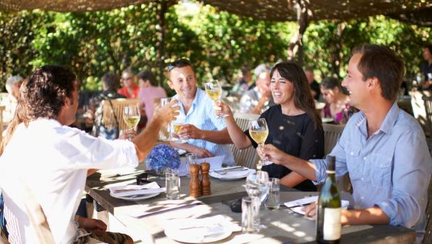 Tourists enjoy wine and food at Black Barn Vineyards in Hawkes Bay.