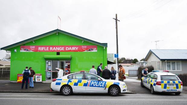 Police at the scene of a robbery on Rifle Range Dairy.
