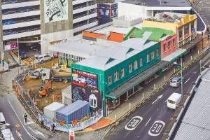 The bare land behind the buildings being sold is part of a rejuvenation plan by Wellington City Council for the Victoria ...