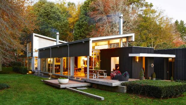 The Bark House is Kate and John Clarkson's family home on the outskirts of Hamilton; the boldly angled black pavilions ...