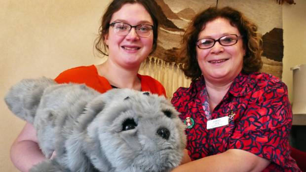 Enliven Southland quality of life co-ordinator Shannon Tokona and nurse Julie Worner with Paro the robotic seal, who is ...