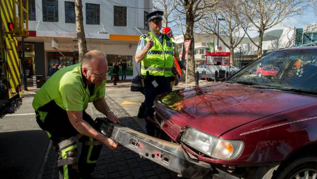 Police and Fire Services worked to clear a car crash scene, on Trafalgar St in Nelson on Friday.      18082017 NEWS ...
