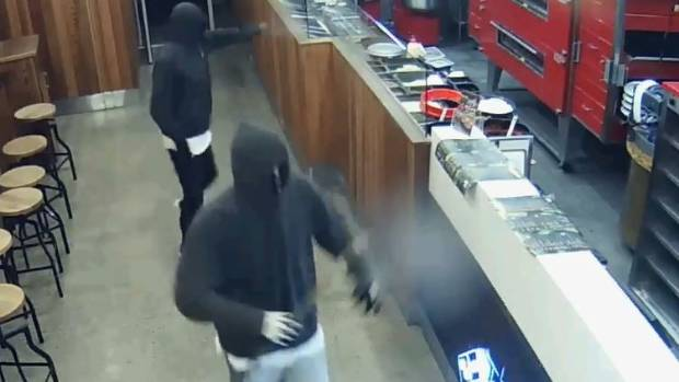 Police are still looking for these two men in relation to the robbery of a Domino's pizza outlet in Hamilton.