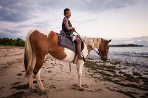This boy and his father offered tourists rides on horses along Natadola Beach in Fiji, where  I stayed there in April. ...