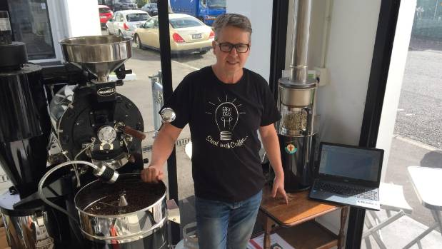 The Coffee Workshop co-owner John Robson with an older micro roaster (left) and a small computerised one (right).