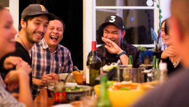 James Roque (centre) sits next to Chye-Ling Huang's father during the dinner party that started it all.