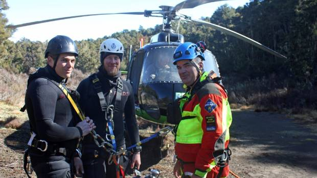 Police dive squad have joined the sixth day of the search for two men missing in Tongariro National Park.
