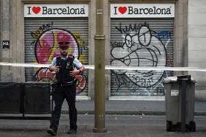 A police officer patrols on Las Ramblas following yesterday's terrorist attack in Barcelona, Spain.