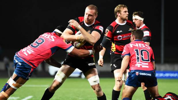 Canterbury player Dominic Bird gets tackled.