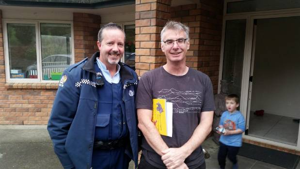 A police officer turns up to talk to columnist Damien Grant about a tweet he sent.
