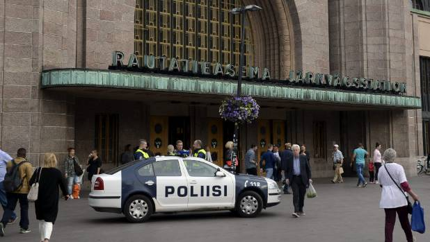 Finnish police patrol in front of the Central Railway Station in Helsinki, after stabbings in Turku.