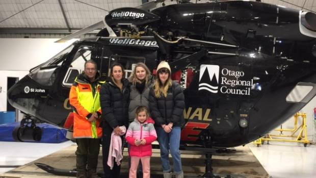 Chris Coory, of LandSAR, with the rescued group, from left, Melissa Bowley, Lauren Rees, Meg Pidegeon and Skyla Bowley, ...