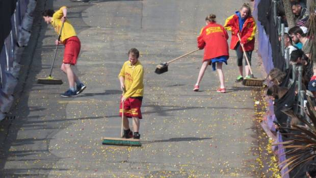 Volunteers sweep Jaffas during the annual Cadbury Jaffa Race