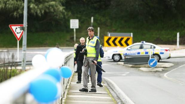 A forensic photographer on Ferguson Bridge in Cambridge shortly after the accident. The blue and white balloons on the ...