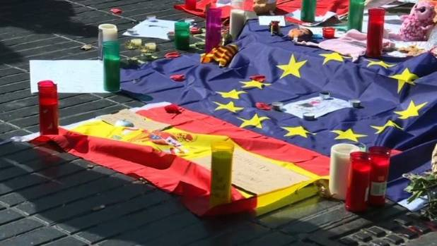 Barcelona Mourners lay flowers at Plaza de Catalunya