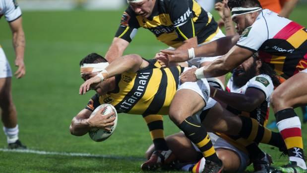 Taranaki hooker Sione Lea strives forward against Waikato.