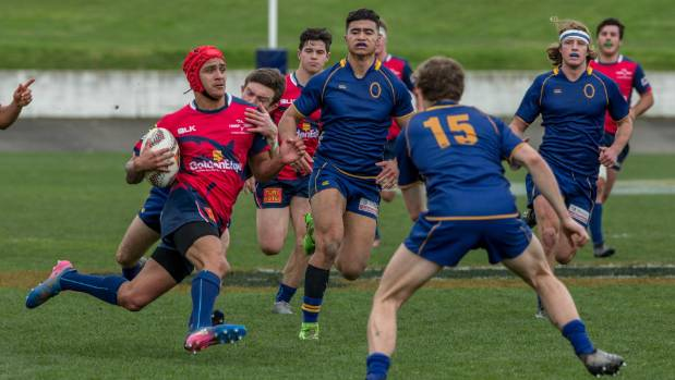 Tasman centre and captain, Rupena Parkinson, breaks Otago's defensive line.