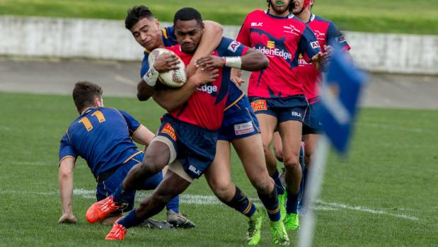Tasman winger Timoci Tavatavanawai is tackled by Otago centre Trevor Smith.