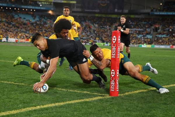 All Blacks wing Rieko Ioane scores in the corner in the first half.