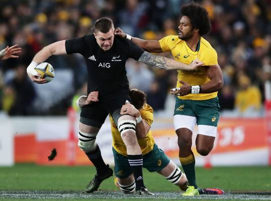 All Blacks loose forward Liam Squire struggles to break through tackles.