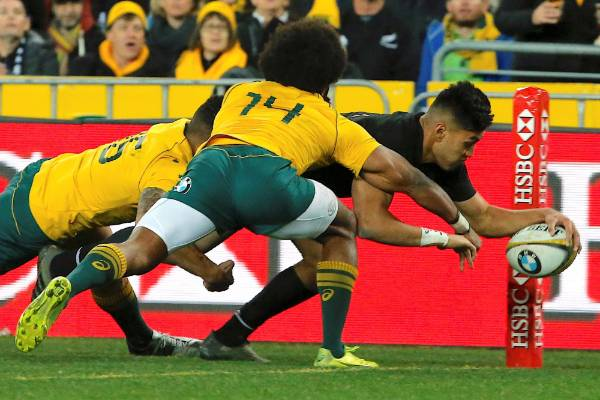 All Blacks wing Rieko Ioane stretches to score a try.