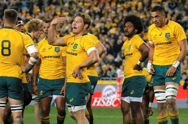 Wallabies captain Michael Hooper shows his frustration as the All Blacks run riot in the first half.