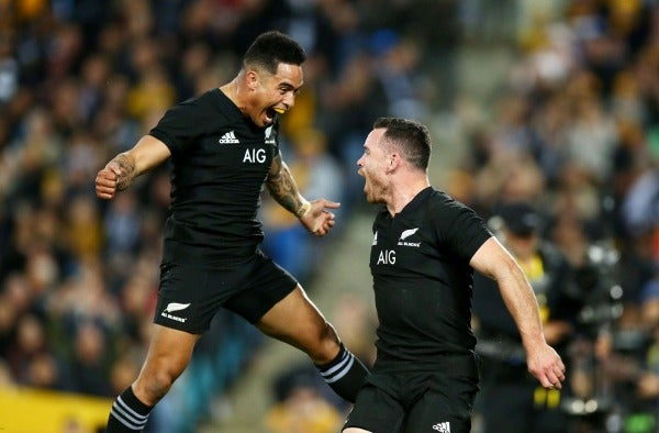 Aaron Smith and Ryan Crotty celebrate an All Blacks try.