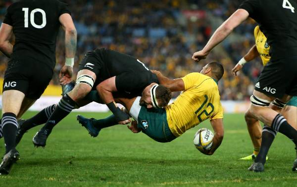 Wallabies second five-eighth Kurtley Beale is tackled by All Blacks captain Kieran Read.