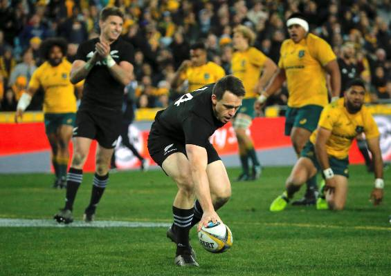 Ben Smith puts the ball down to score a try for the All Blacks.