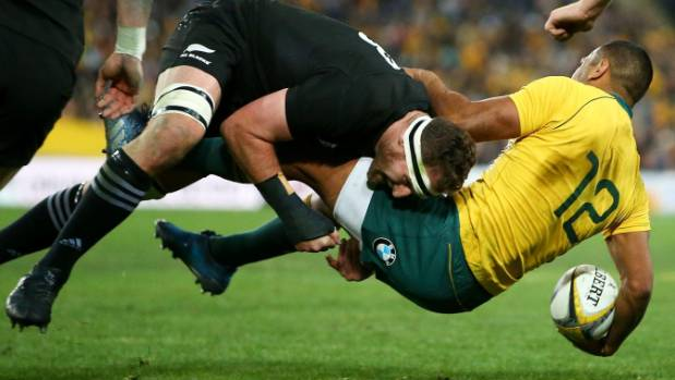 Beale gets tackled hard against the All Blacks