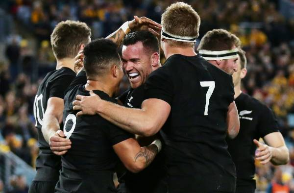 All Blacks centre Ryan Crotty celebrates a try with his team-mates.
