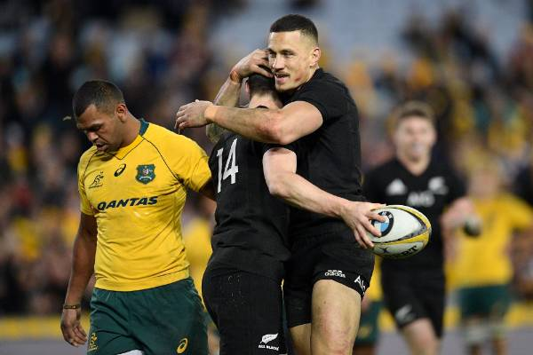Ben Smith celebrates his try with All Blacks team-mate Sonny Bill Williams.