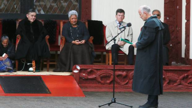 King Tuheitia, far left, listens to The Opportunities Party leader Gareth Morgan's speech at Turangawaewae Marae in ...