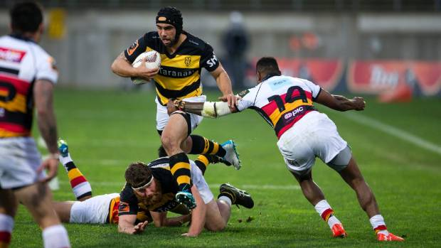 Charlie Ngatai jumps over Mitch Graham as he tries to go through the Waikato defence.