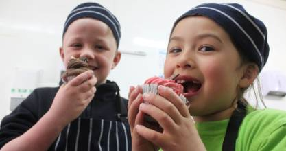 Baxter Christiansen, 8 and Anne Porteous, 8, of Cromwell Primary School taste test two of the 300 cupcakes made by high ...