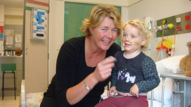 Jo Allen with daughter Ruby, 18 months, at Christchurch Hospital. Ruby is now 9 years old and her parents are founding ...
