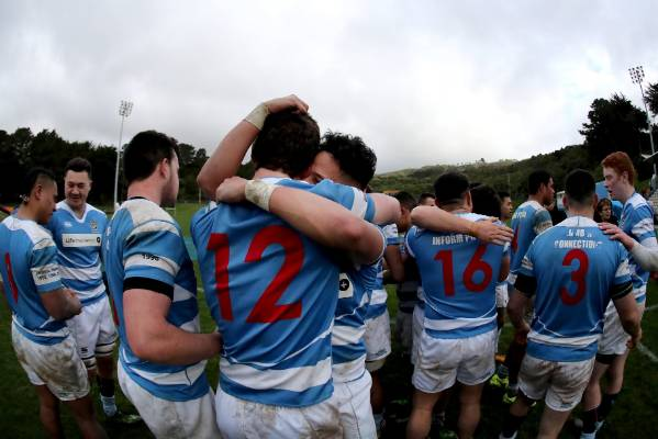 St Patrick's College, Silverstream's Kienan Higgins embraces a team-mates after winning the WelTec Premiership final ...