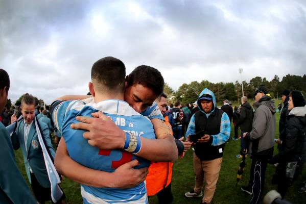 St Patrick's College, Silverstream's Stanley Paese (3) embraces a team-mate after winning the  WelTec Premiership final ...
