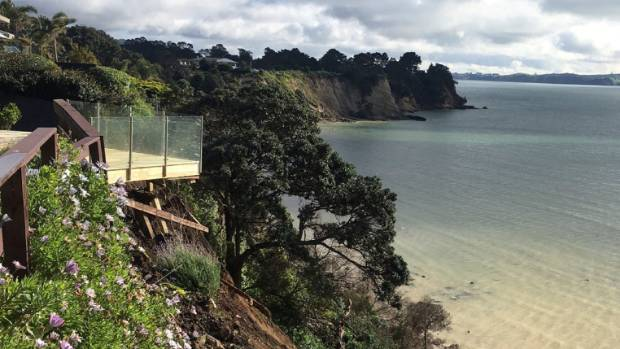 A view from a neighbour's backyard of the residential land slip at the Clovelly Road property, at Eastern Beach, East ...