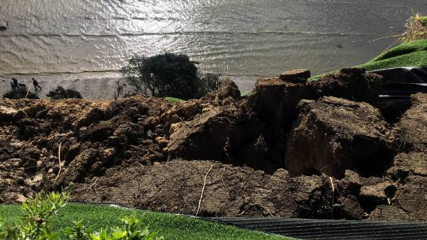 The landslip damage from the clifftop, with Eastern Beach waters below.