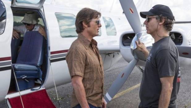 Tom Cruise and Doug Liman on the set of American Made.