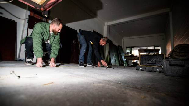 Our Place owners Russel Laird, left, and Mark Louis measure up the new bar layout as refurbishments get underway ...