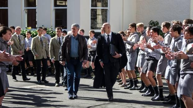 Graham Mourie & NPBHS headmaster Paul Veric walk through a rousing haka by school students.