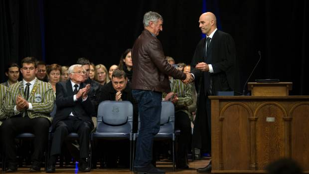 All Black legend Graham Mourie is presented with the Alumni Meriti award by NPBHS headmaster Paul Veric.