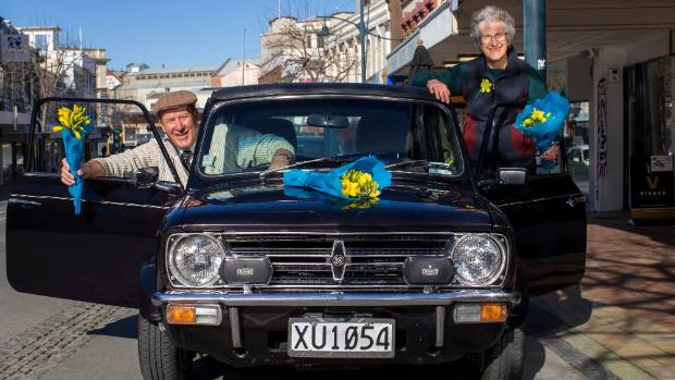 South Canterbury Vintage Car Club members Grant Mitchell and Marion Foster help deliver some of the more than 32, 0000 ...