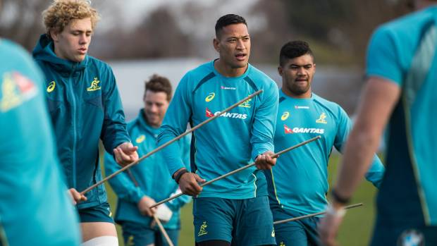 Israel Folau and his Wallabies teammates perform a practice drill.