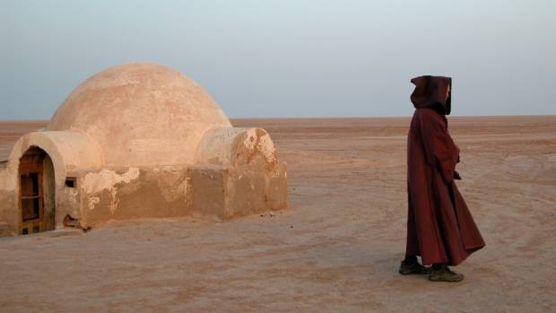 A Star Wars fan in Tunisia at the set for Luke Skywalker's home on the desert planet Tatooine.