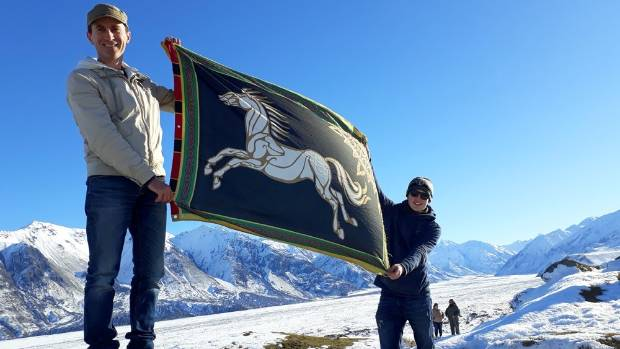 Lord of the Rings fans produce a Rohan flag at Mt Potts Station, which stood in for the Rohan capital Edoras in the film.