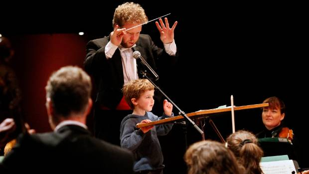 Luke Di Somma conducts the Christchurch Symphony Orchestra in 2014 at a special concert for young children.